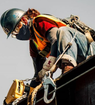 Construction worker using fall protection
