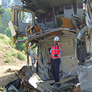 Image of Dave Tyrell standing with a train crash.