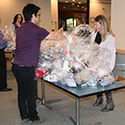 Volpe staff assemble personal care kits.