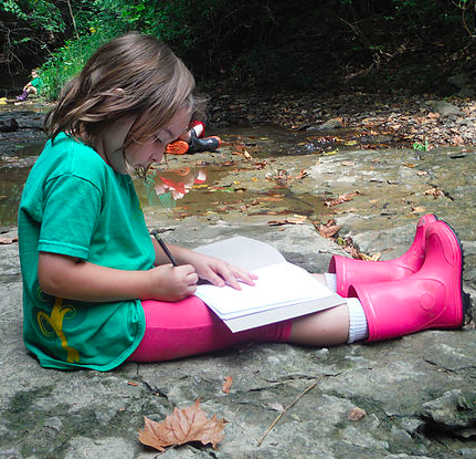 Raintree School student writing about nature