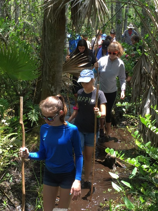 FAU Lab School District middle school students hike on the nature trail.
