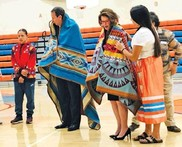 U.S. Deputy Secretary Mitchell Zais participates in a traditional round dance with students at Arrow Creek Elementary