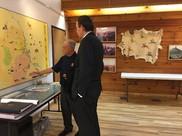 Oglala Lakota College President Thomas Shortbull discusses the history of the Lakota people with Deputy Secretary Zais.