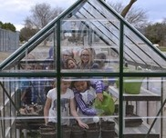 Students learn in a greenhouse in a rural U.S. Department of Education Green Ribbon School.