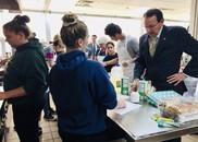 Dr. Zais visits CTE classrooms at T.F. Riggs High School.