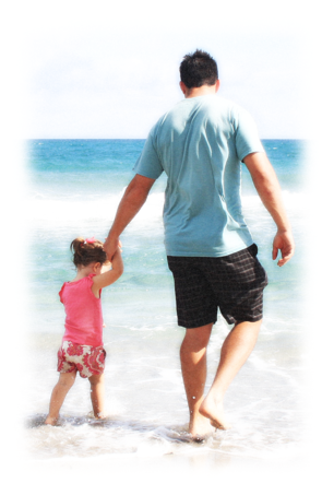 Dad and daughter on a summer beach