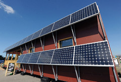 photo of a house with a PV array of 19 panels on the exterior side