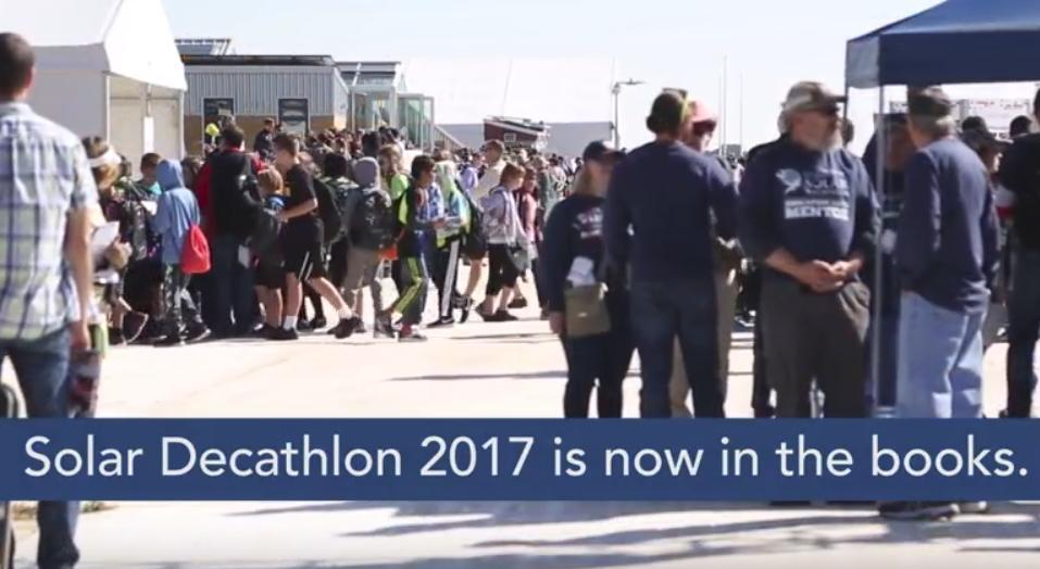 Photo of a crowd at Solar Decathlon with the words