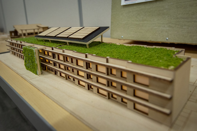 A photo of a model house with grass on the roof.