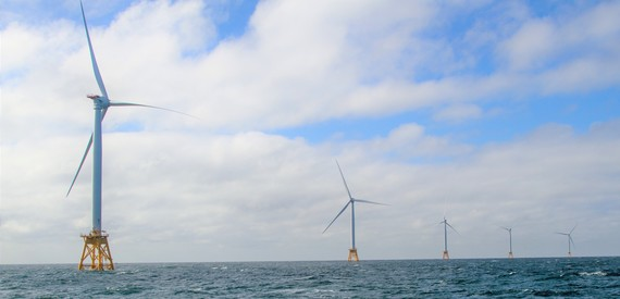 Offshore wind turbines at sea.