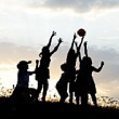 Silhouette of kids playing outside