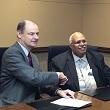 Drs Burke and Benjamin shake hands after signing MOU