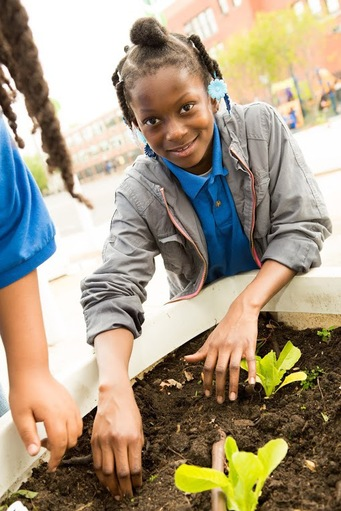 Girl in the garden at Chicago Public Schools