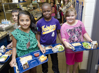 Students with lunch trays