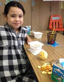 Girl Eating SchoolBreakfast