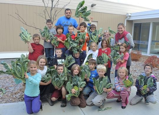 Children holding greens