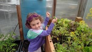 Preschool girl playing in garden