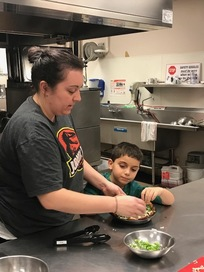 adult and child cooking