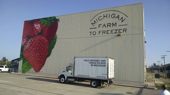 A delivery truck is parked in front of the Michigan Farm to Freezer warehouse.
