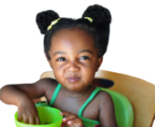 Young girl eating from green bowl