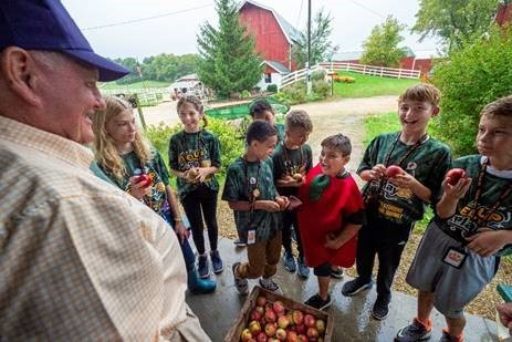 Secretary Purdue with students at Eplegaarden Apple Orchard with