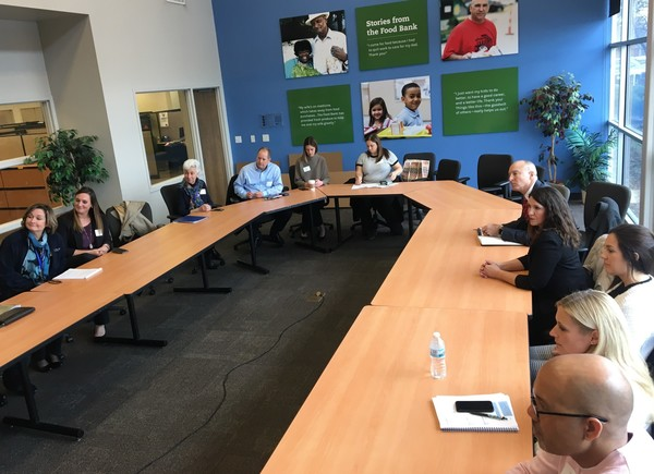 Image of staff at Food Bank conference table