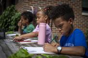 Kids writing in garden