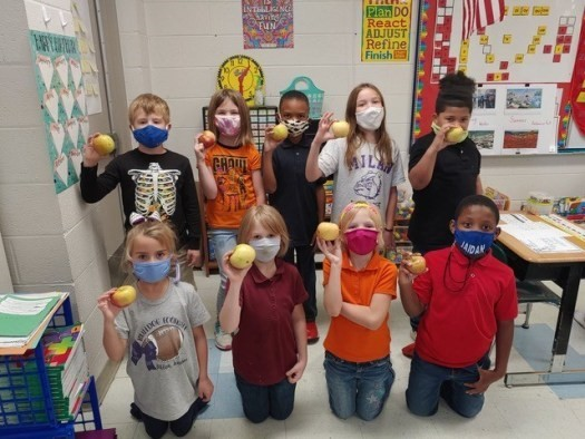 Students participate in apple crunch