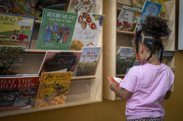 Girl reading books about local food
