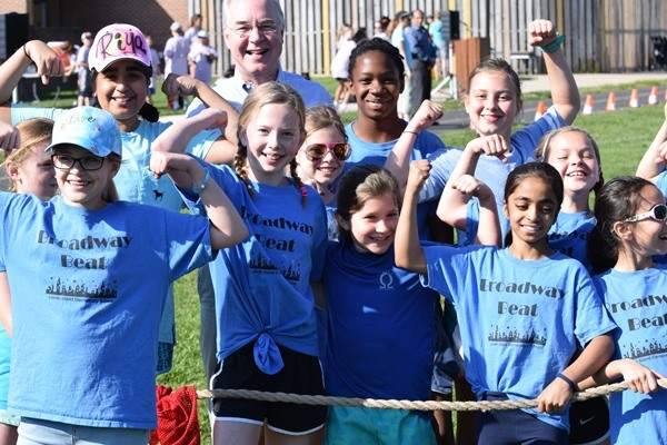 HHS Secretary Tom Price with children at an elementary school field day