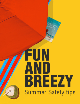 Fun and Breezy Summer Safety Tips. Coconut drink, beach towel, and book under a beach umbrella.