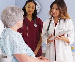 patient talking with a doctor and a nurse at a health center
