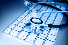Image of a stethoscope on a keyboard