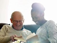 image of a young woman reading a book with an elderly man