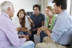 a photo of five people having a discussion