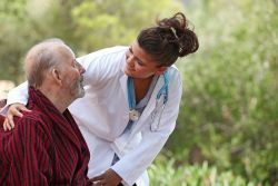 Photo of a doctor checking on a patient