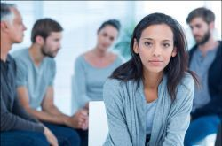 picture of several people at a group therapy session