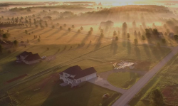 photo from above of a sunset over a rural scene