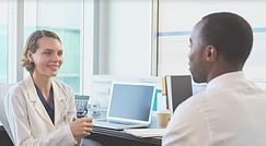 doctor and patient talking in an office