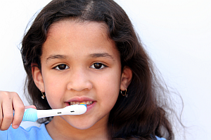 photo of a girl brushing her teeth