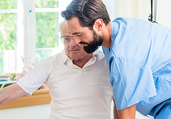 photo of a health care worker assisting an elderly patient