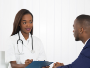 A doctor seeing a patient to discuss his health