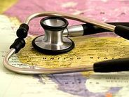 map of the us with a stethoscope lying on top of it