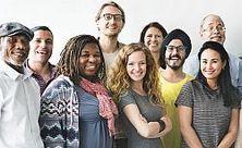 photo of nine smiling people