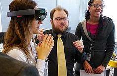 HRSA grantee Jordan Berg demonstrates a digital viewer to FORHP's Jennifer Burgess (left) and Whitney Wiggins.