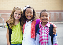 photo of three elementary school children