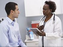 photo of a doctor speaking with a patient