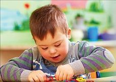 photo of a child playing with toys