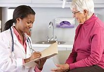 photo of a female doctor with a female patient
