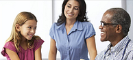 stock photo of a school health worker with a mom and her daughter